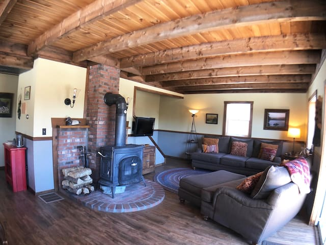 Living room loveseat and woodstove. Great place to relax after a day on the trails!
