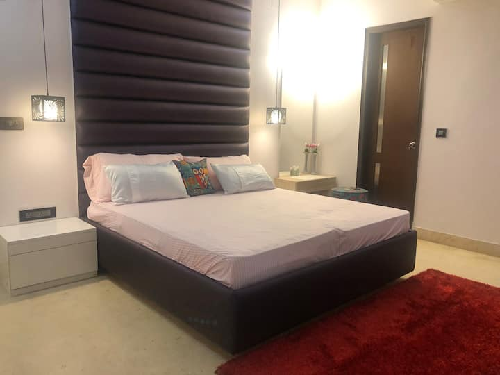 Enjoy a spacious master bedroom in south Delhi