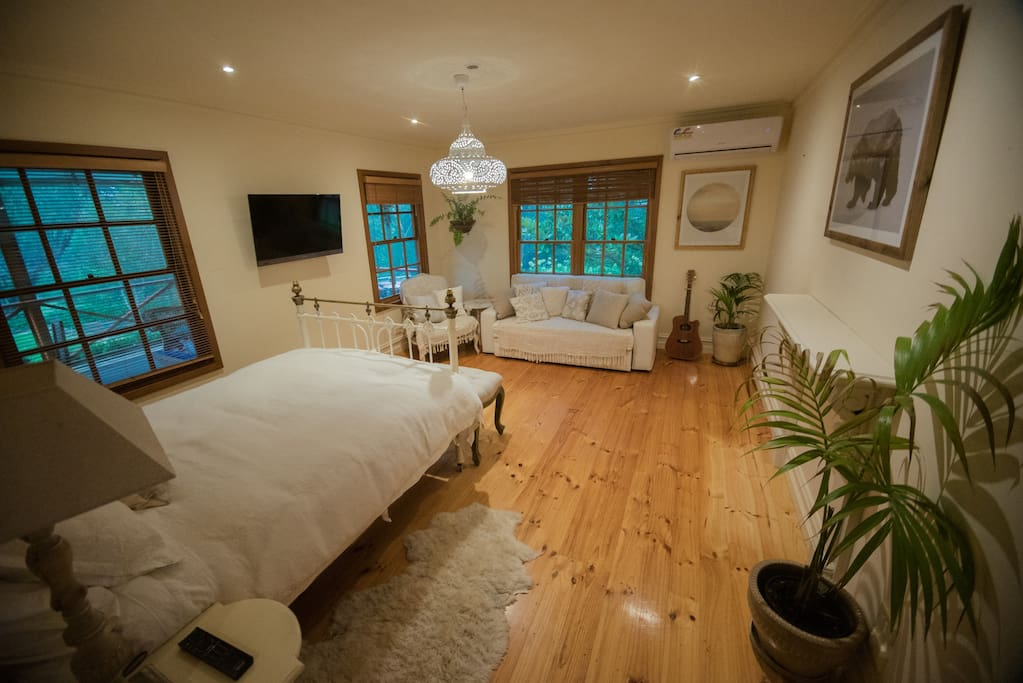 Master bedroom with queen bed , TV on wall to turn for either lounge or bed watching