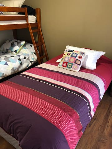 Second bedroom- one king single, two singles(bunk bed)