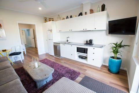 Living area and kitchenette. Dishwasher, fridge, microwave