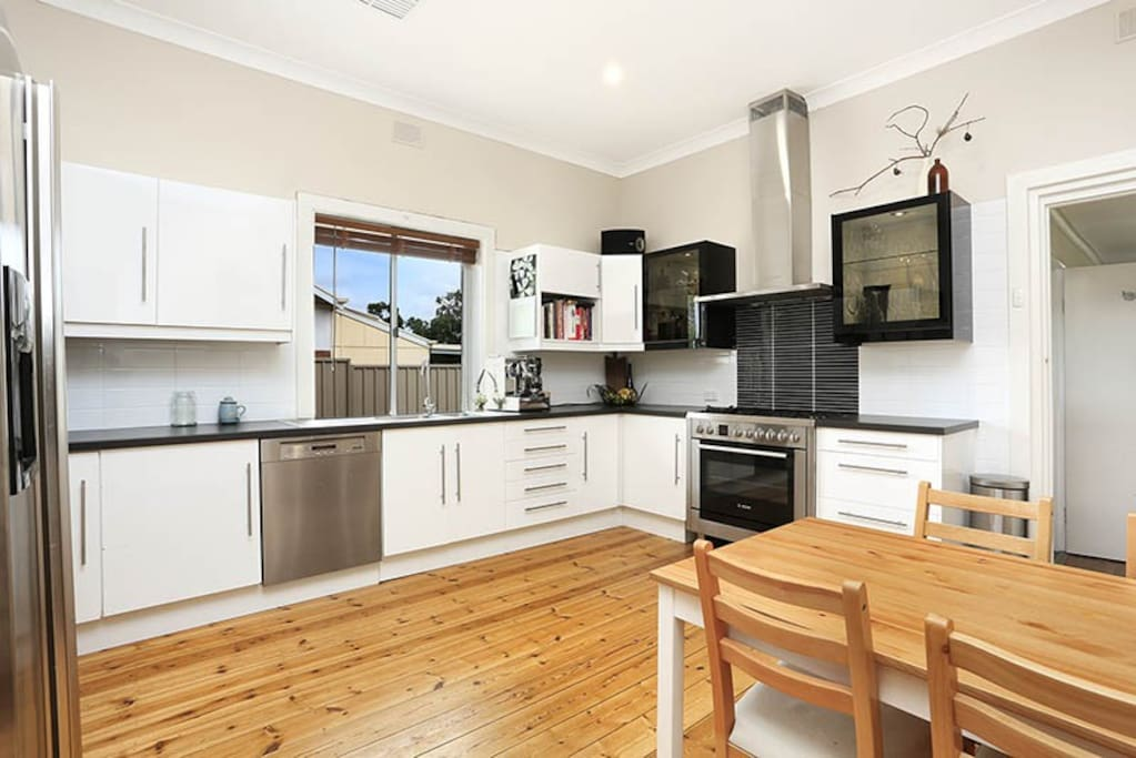 Open plan kitchen with great appliances.  Bosch 5 burner gas stove and miele appliances