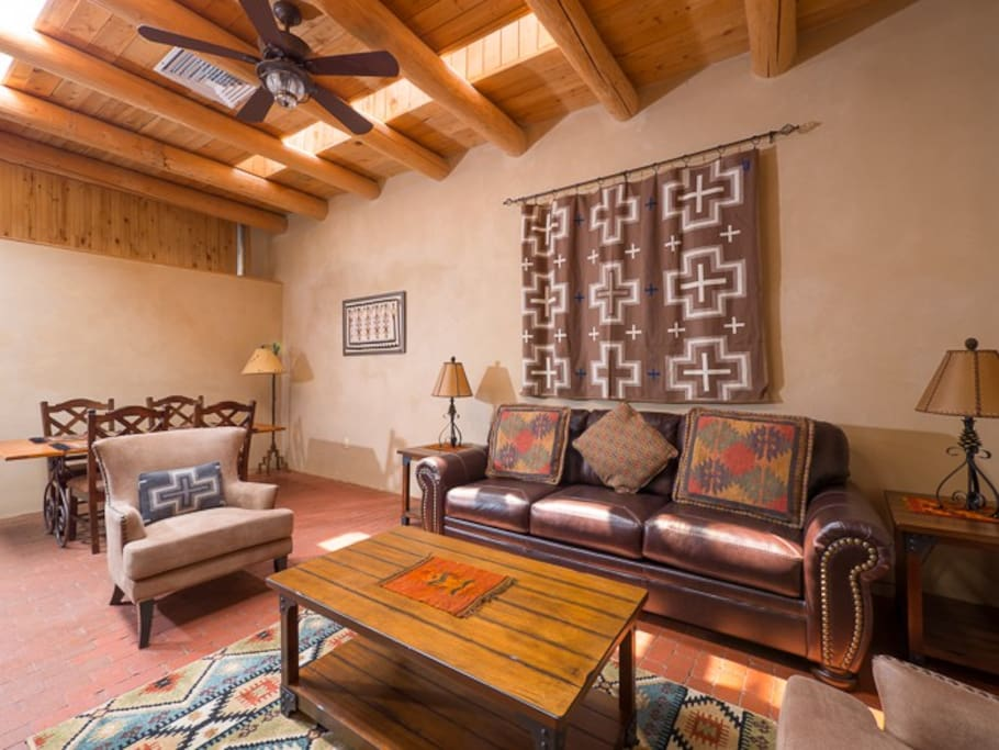 Living area features a flat screen TV and queen sleeper sofa