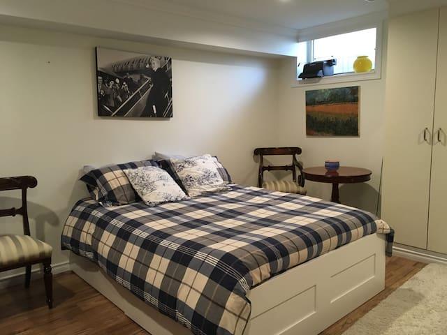 queen sized bed in basement
