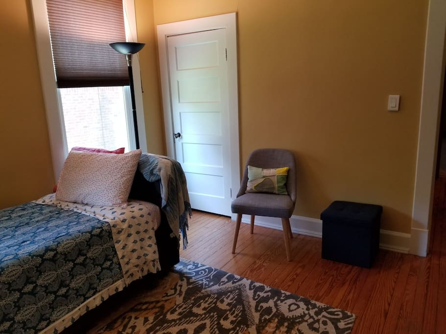 Room features plenty of storage, cozy chair to kick back and relax.