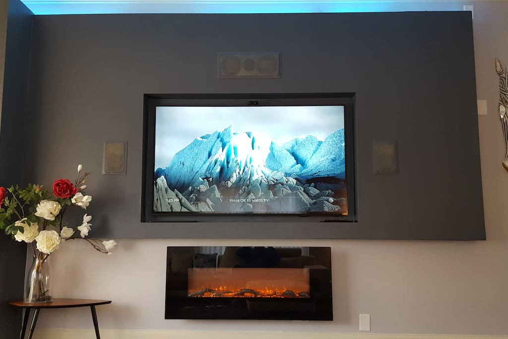 "Built in houses 75"" TV, surround sound and Ambient (not heating) fireplace"