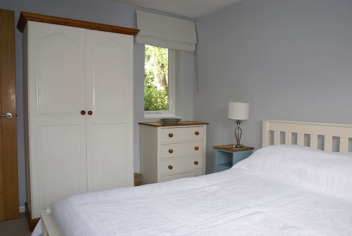 Double aspect bedroom overlooking the church and garden