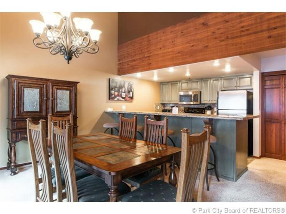 dining table for 6, breakfast counter for 4, fully-stocked kitchen w/granite counters and stainless appliances, microwave, dishwasher, keurig coffeemaker, and assorted smaller appliances (hand blender, rice cooker, panini grill, etc)