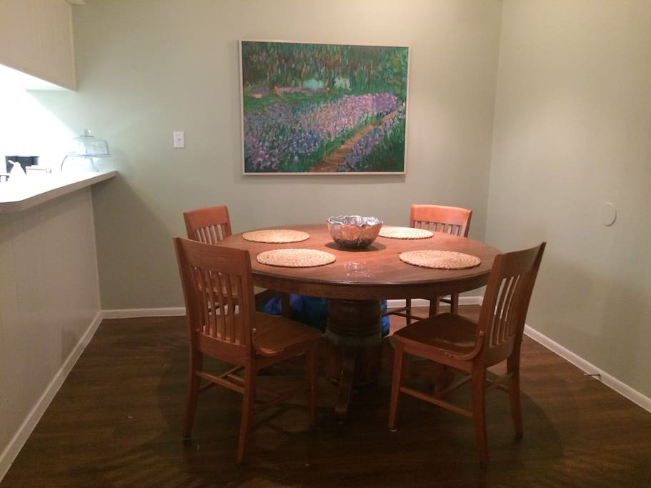 The dining table provides ample seating for everyone.