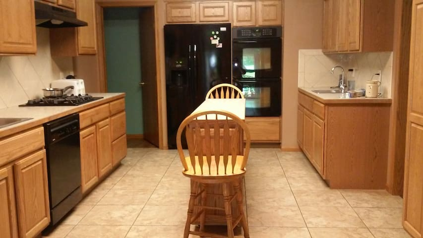Spacious  Kitchen, double ovens, 2 sinks, counter top gas stove, coffee pot ....