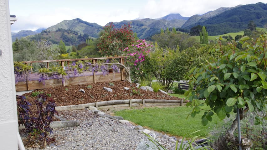 Sunny deck at front of house with stunning views towards Mt Arthur Range, Kahurangi National Park.