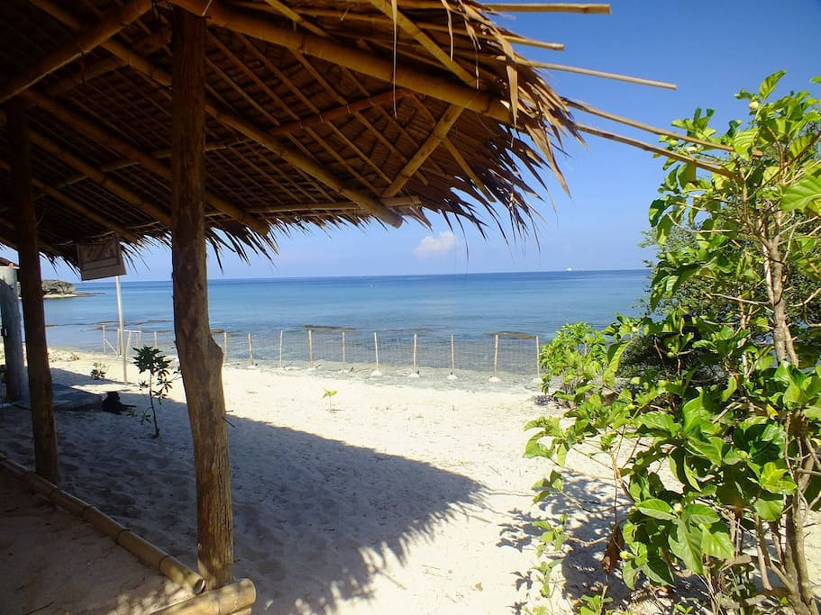 Direct beachfront with white sand. An outside salar gives you the amenity of a private cosy, shadowed place.