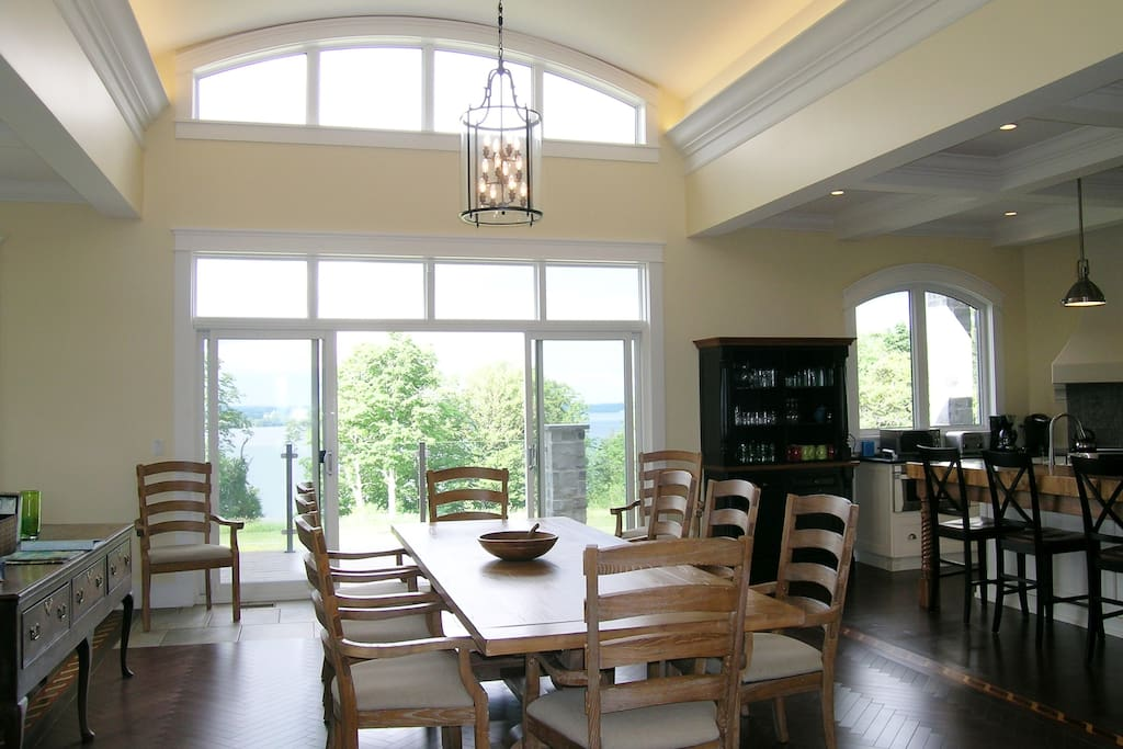 Dining room seats 10, all with arm chairs, double sliding door walk out to deck