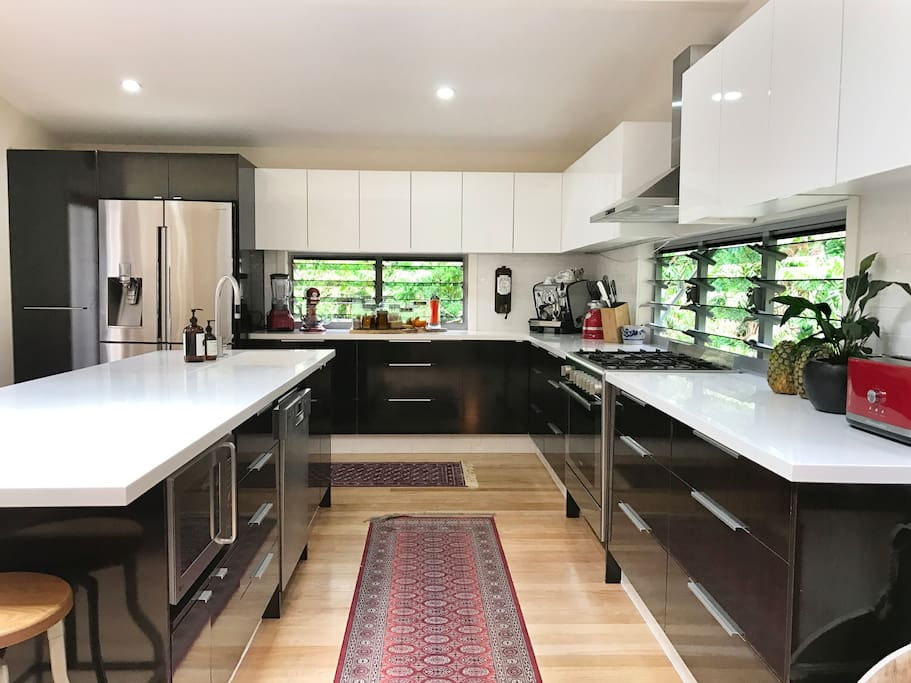Huge kitchen with European appliances.  Lush views through banks of louvre windows make it a wonderful place to cook and eat