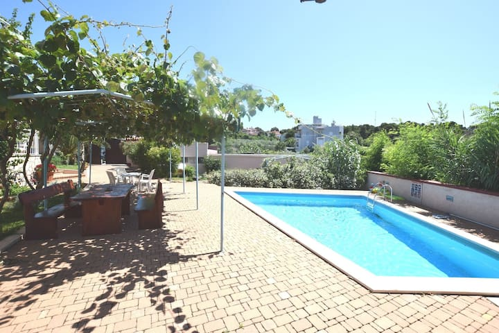 Studio in holiday home with pool, barbecue area, fenced garden and great views