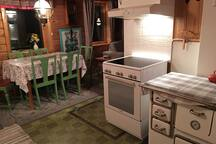 First floor kitchen: kitchen table for 6 person. Hobs and oven.