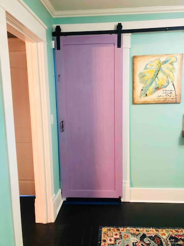 The staircase to your space is behind the purple door