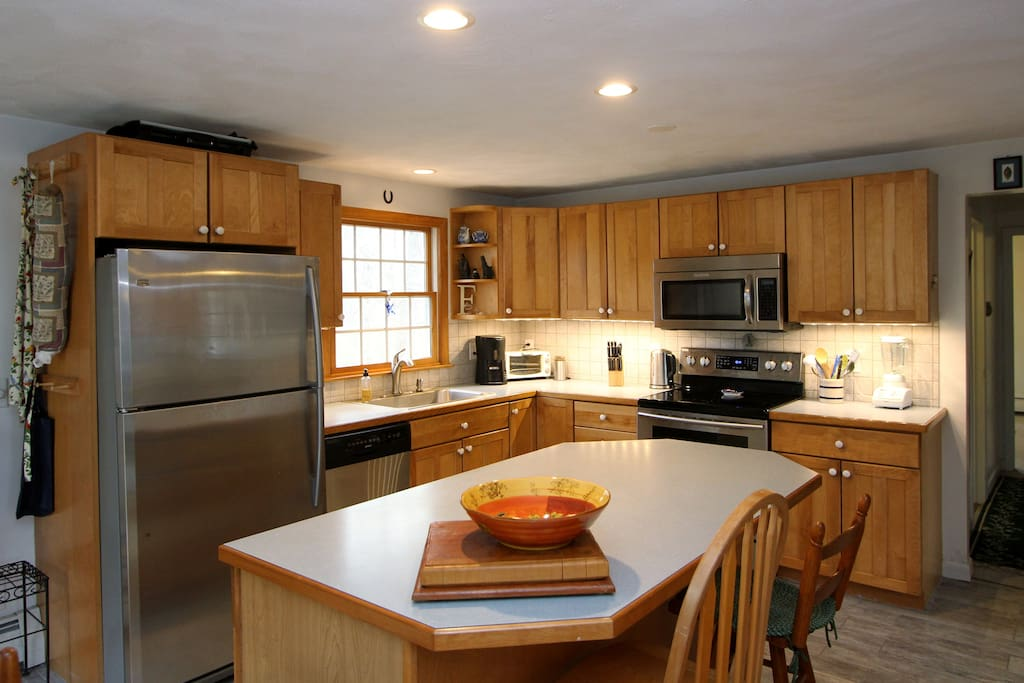 The kitchen has plenty of counter space and stainless steel appliances.