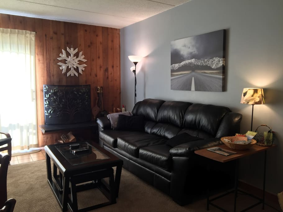 Living Room with leather couch,  deck, wireless access tv & dining area