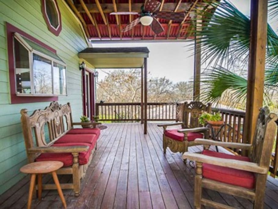 The front porch is very spacious and with deck fan and vaulted ceiling.