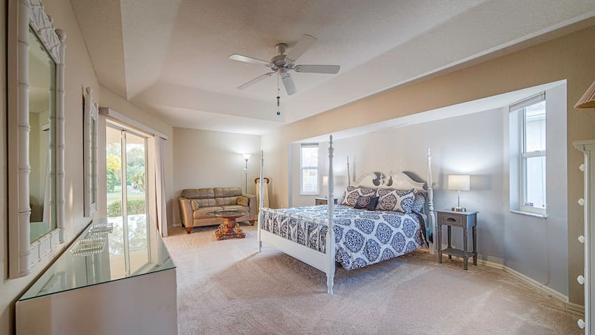 The master bedroom offers a new queen bed, leather love seat with reading lamp, and 2 dressers.  Lighted night tables on either side of the bed offer a convenient location for your nighttime personal effects.