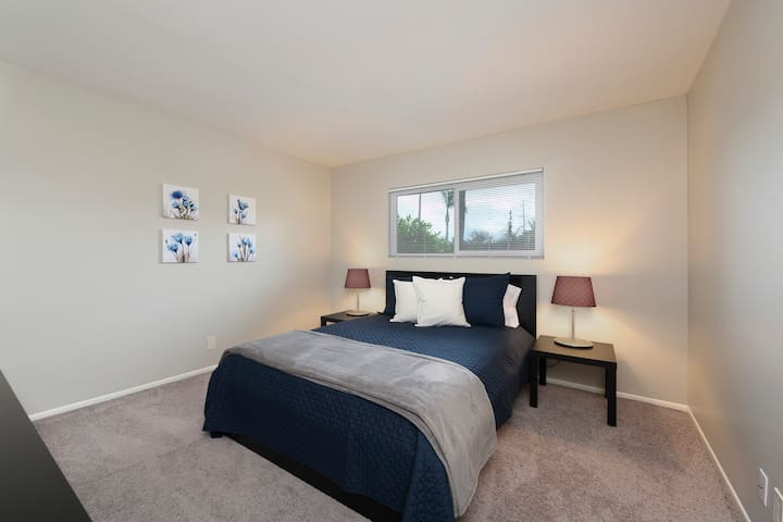 Third bedroom with dresser and closet.