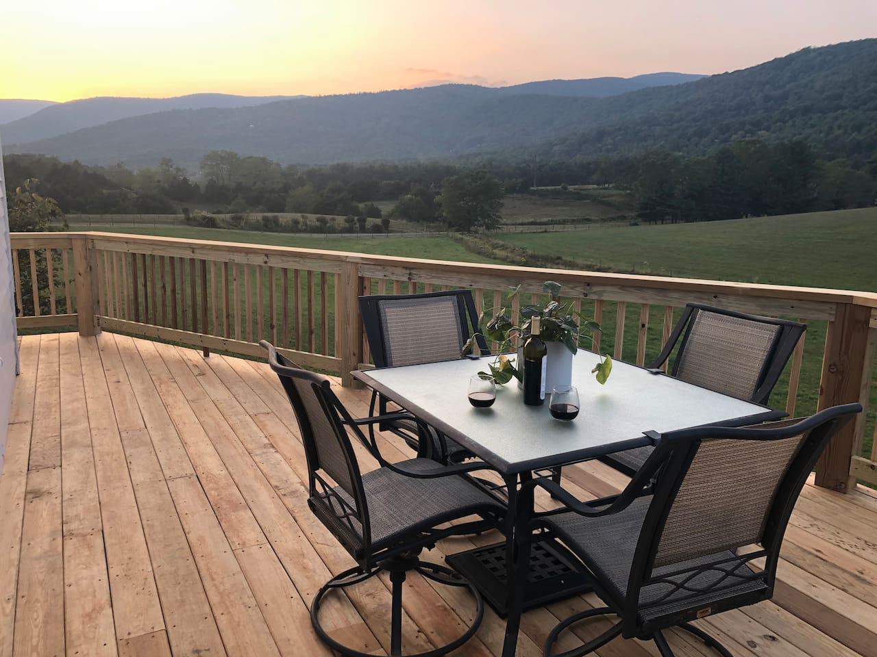 Enjoy the sunset on the back deck of the cottage