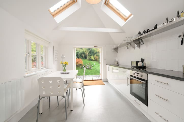 Fully equipped kitchen/dinner with French doors leading to the terrace and southwest facing garden.