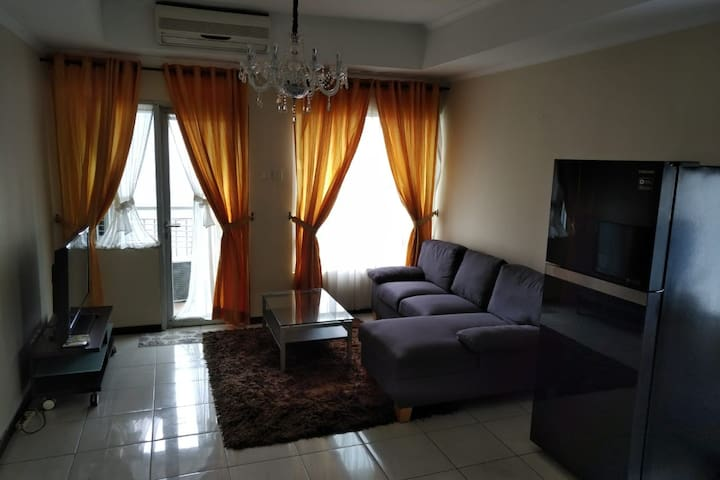 Spacious 3 BR Sudirman Park Apartment with WiFi.