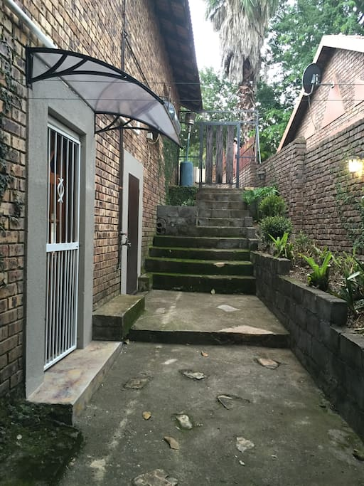 Private entrance along the side of our house to the garden flat.