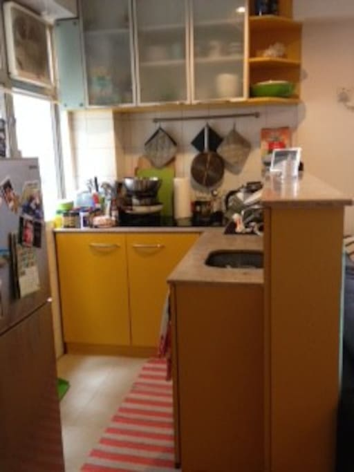 The kitchen is not big, but it works, and it is open to the rest of the space.