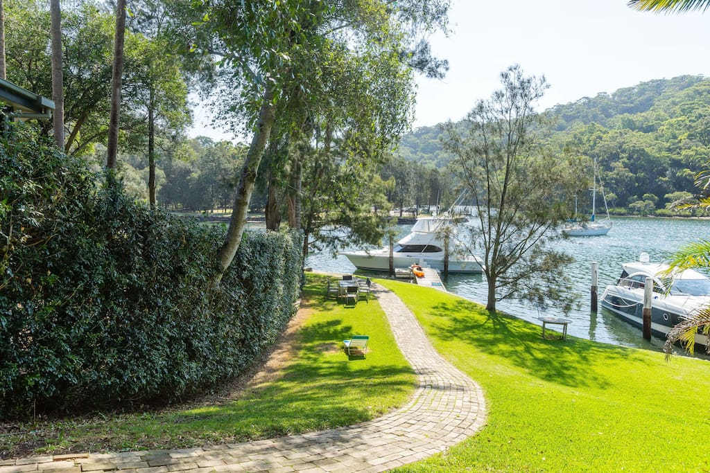 Waterfront with lawn, jetty, swimming and kayaking facilities
