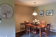 Dining room area with dining room table and 6 chairs.