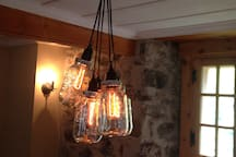 Unique vintage light with stone wall, dinning area
