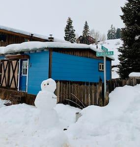 Blue Cottage on Corner of Zen & Nirvana