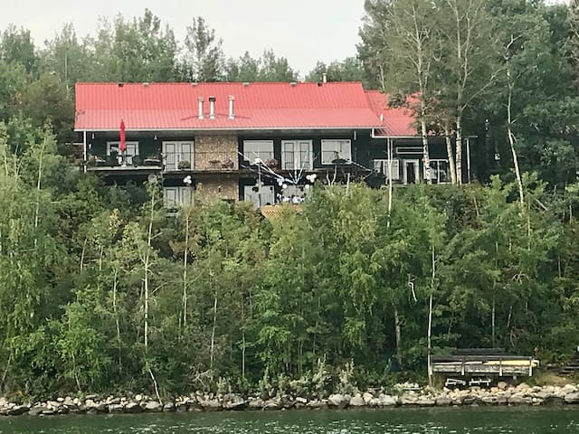 Stunning Sylvan Lake Beach-Front Home with View