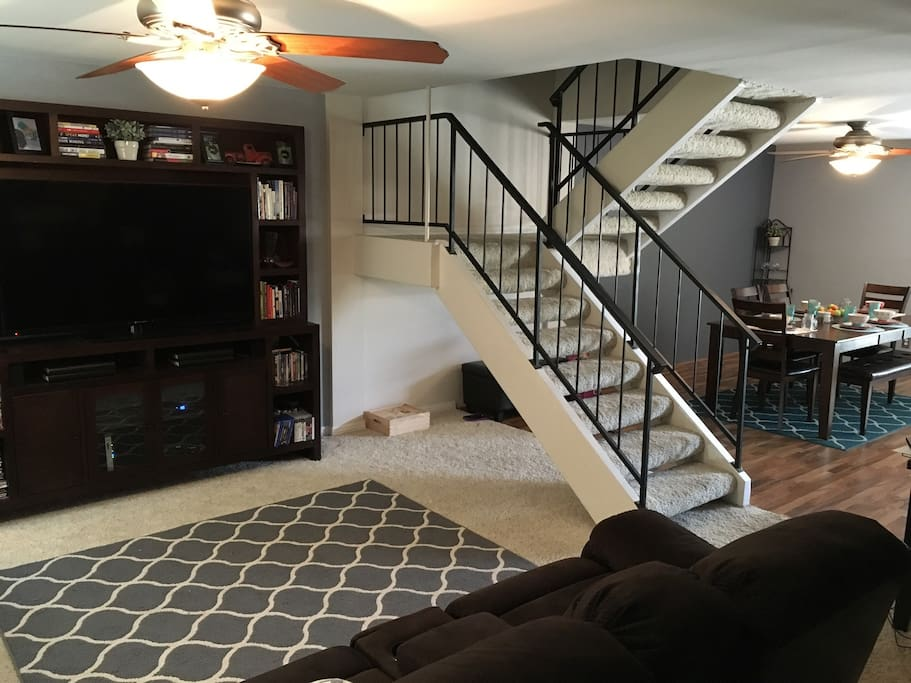 Living and dining room, stairs leading up to 3 bedrooms and 2 bathrooms.