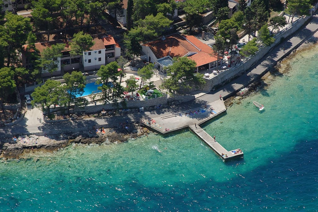 Aerial view. Our apartments can be seen here with their prime position overlooking the sea.