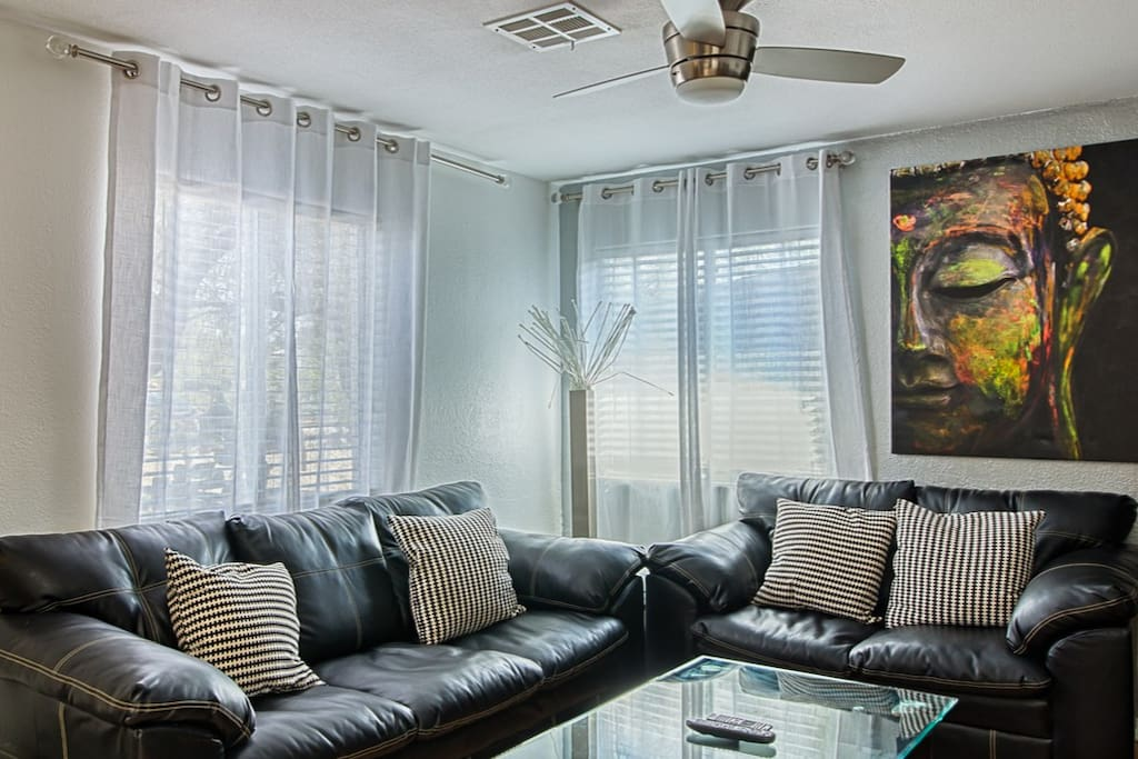The living area offers comfy sofa's and a huge 70 inch TV/ high speed internet .