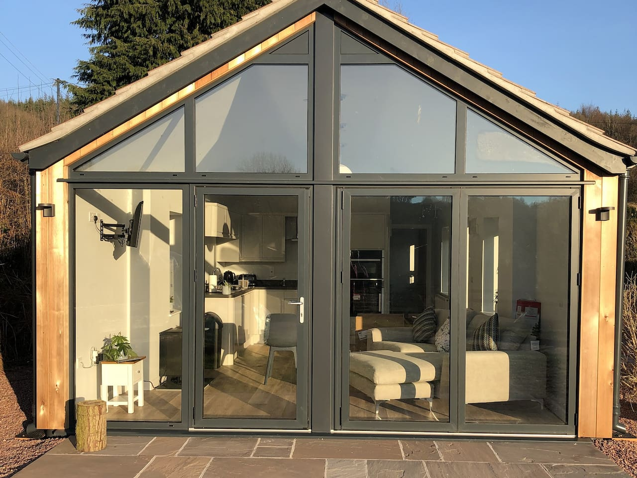 Glass front with bi-fold opening windows. Stunning views.