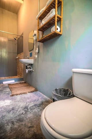 The bathroom includes towels and free toiletries.