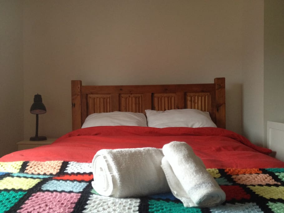 Hand made solid wood double bed.