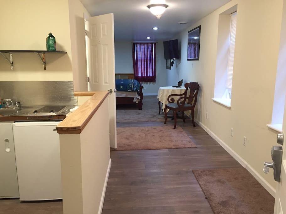 Looking from the entrance. The kitchen is to the left and a bathroom is located on the left between the kitchen and the bedroom.