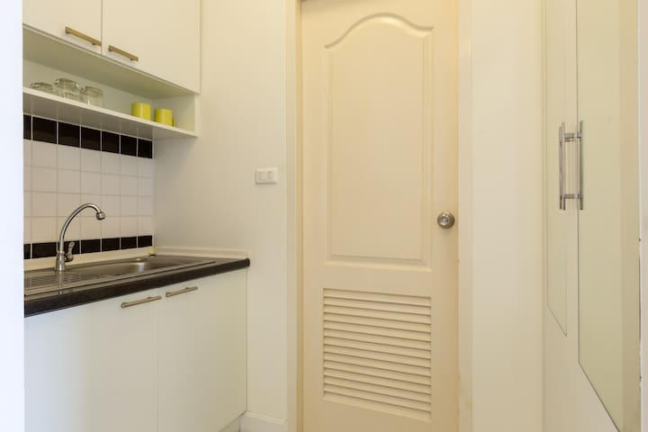 Kitchenette and door to the Bathroom