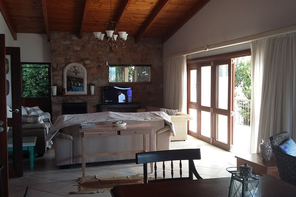 Large living area with folding doors to the balcony