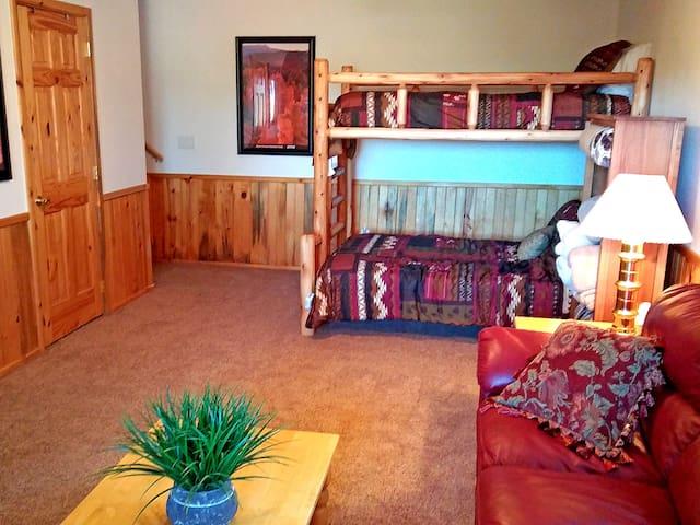 Basement bedroom bunk beds sleep 3 people.