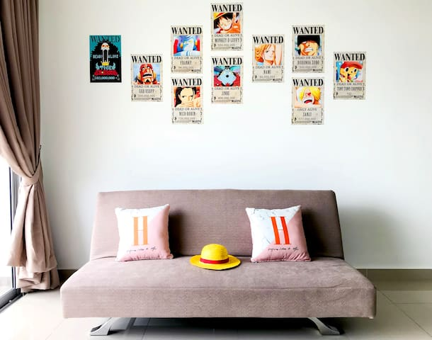 Living room area with crew of straw hat posters