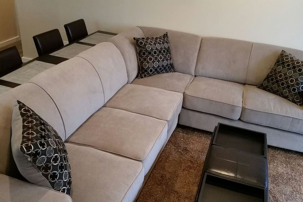 Large L shaped sectional with queen size sleeper!