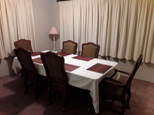 Large dining room with room for at least eight