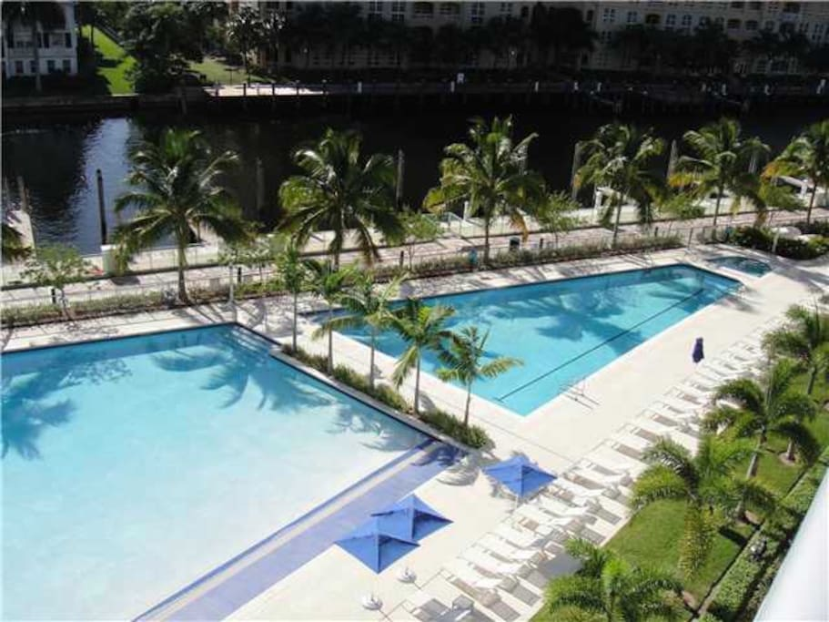 Two swimming pools and pool deck